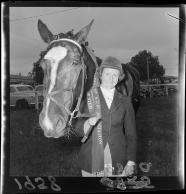 Image: Unidentified female equestrian with her horse, winners of champion hunter award at the Palmerston North Agricultural & Pastoral Show (A & P Show), Manawatu-Whanganui Region