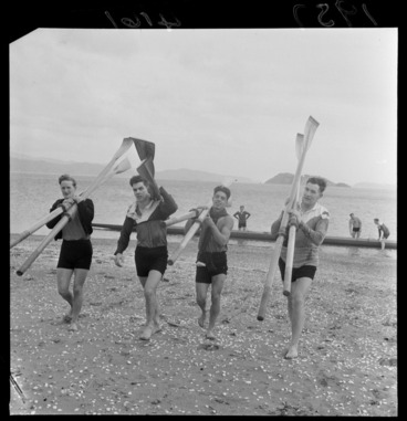 Image: Four unidentified rowers carrying oars, on beach at Petone, Lower Hutt City