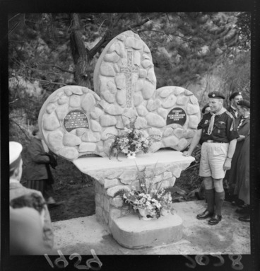 Image: Unidentified scout leader with a memorial dedicated to Mary Crowther, Moore's Valley, Wainuiomata
