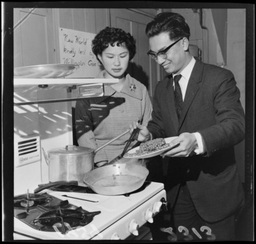 Image: Mr Li and Miss F Wong Shee, demonstrating Chinese cookery on a gas stove, probably Wellington
