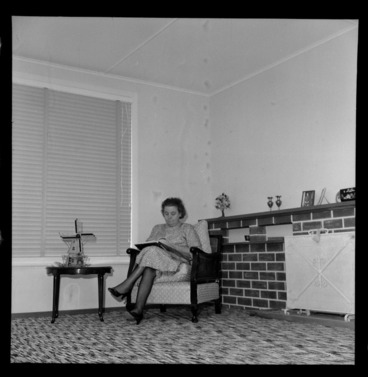Image: Mrs Mabel Howard, in her new house in Karori, Wellington, showing her sitting in a chair