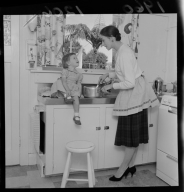 Image: Mrs Walter Trevor (Sara Neil), ballerina, at home with her young daughter in the kitchen