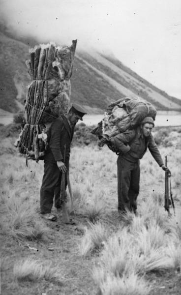 Image: Men carrying deer skins