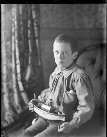 Image: Owen William Williams, with a model ship of the 'Apollo', probably at his home, Royal Terrace, Kew, Dunedin