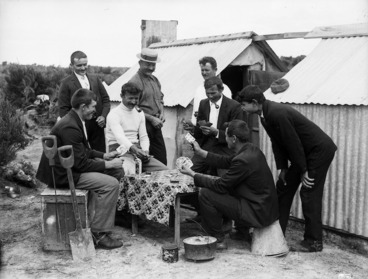 Image: Gum diggers playing cards in camp