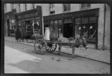Image: Street scene, with donkey and cart outside of shop, Killarney, County Kerry, Ireland