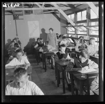 Image: Mrs K Skwaiko watches her pupils study in the boys' classroom at a Polish refugee camp, Pahiatua
