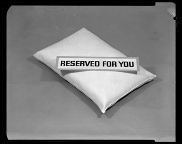 Image: Pillow with 'Reserved for you' sign on top