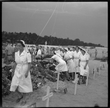 Image: New Zealand nurses placing wreaths on the graves of fellow workers, El Ballah, Egypt, during World War 2