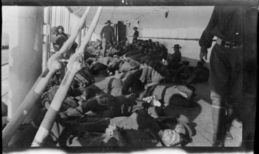 Image: Men of the 9th Battalion lying on the deck of a transport ship taking members of the Australian Imperial Force and the New Zealand Expeditionary Force to Egypt