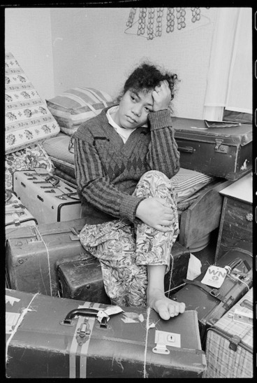 Image: Ana Likio at her home in Waitangirua, surrounded by luggage - Photograph taken by Ray Pigney
