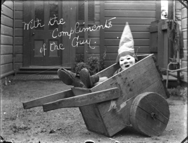 Image: William Godber dressed up for Guy Fawkes celebrations, seated in a wooden wheelbarrow