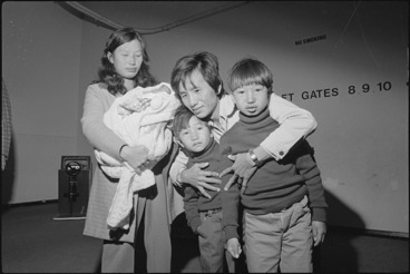 Image: Cambodians Tan Ten Lian and Lauv Muy Fang are reunited with their children at Wellington Airport - Photograph taken by Ian Mackley