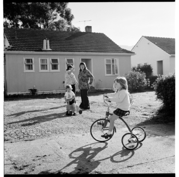Image: Child on a tricycle, possibly in the Avalon area of Lower Hutt