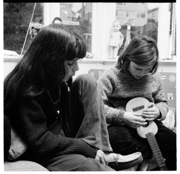 Image: Two young girls with a ukulele, and sketchbook
