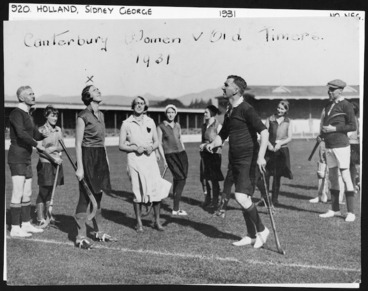 Image: Canterbury women's hockey team versus Old Timers; includes Sidney George Holland in foreground