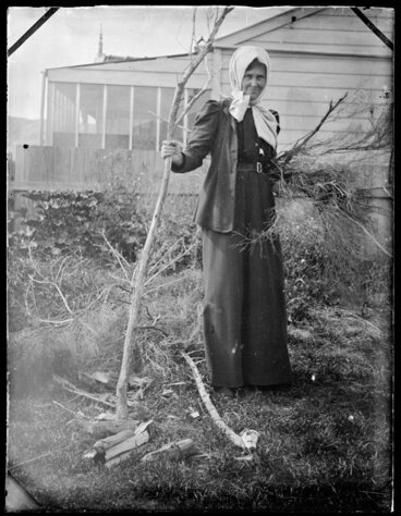 Image: Woman holding branch