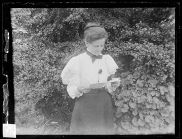 Image: Woman reading in garden