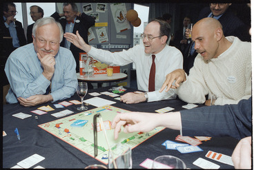 Image: Former Finance Minister Sir Roger Douglas, Reserve Bank governor Don Brash, and Saints basketballer Angelo Hill, playing Monopoly for charity - Photograph taken by Ray Pigney