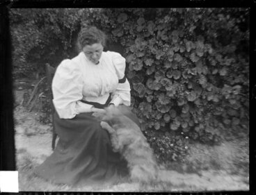 Image: Amy Kirk and dog in garden