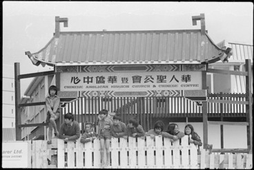 Image: Group alongside the Chinese Anglican Mission gate, temporarily located at St Marks School, Wellington