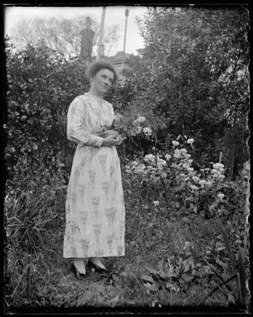 Image: Woman holding sheaf of flowers