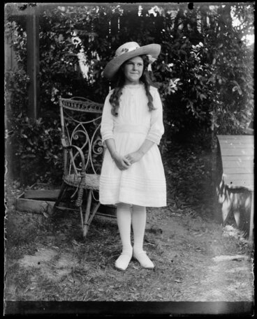 Image: Young girl in garden