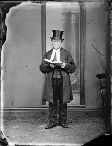 Image: Unidentified man, with an open book