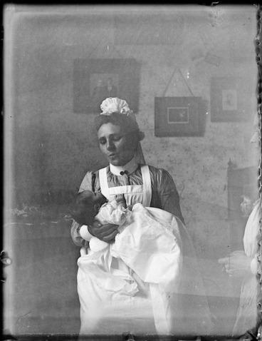 Image: Nurse holding an infant