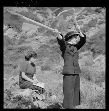 Image: Women's Royal New Zealand Naval Service recruit learning semaphore on Somes Island