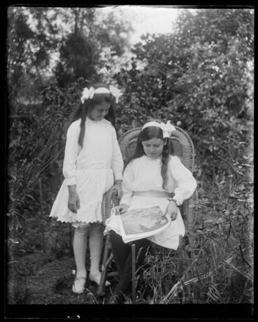 Image: Two young girls in a garden