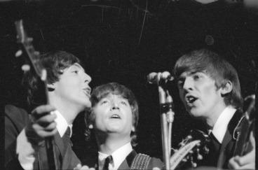 Image: Beatles Paul McCartney, John Lennon and George Harrison singing during their Wellington concert
