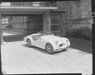 Image: T.R.2 sports car outside art gallery