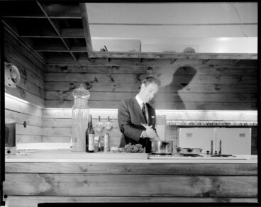 Image: [Studio?] kitchen with a man preparing food, possibly a cooking demonstration