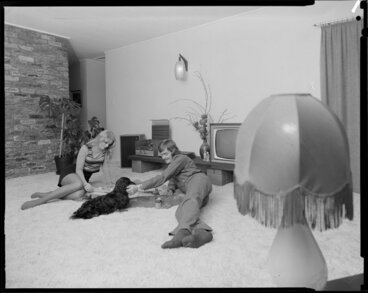 Image: Young people with dog in lounge