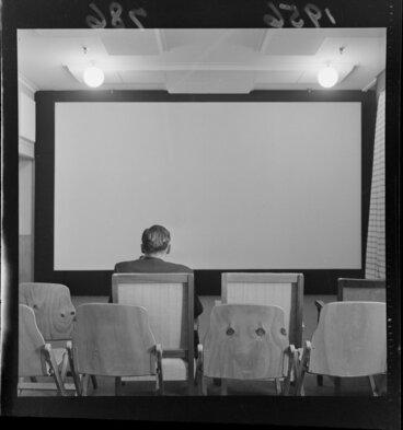 Image: Unidentified man in the screening room of the Film Censor's Office