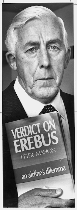 Image: Former High Court judge, and Head of the Commission of Enquiry into the Erebus disaster, Peter Mahon, with his book Verdict on Erebus - Photograph taken by Ray Pigney