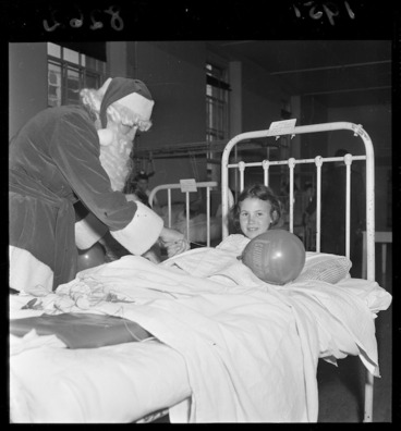 Image: Children in hospital being visited by Santa Claus
