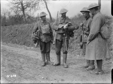 Image: New Zealand soldiers during World War I, with a wounded dove, at Mailly-Maillet, France