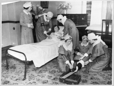 Image: Members of the Order of St John demonstrating first aid