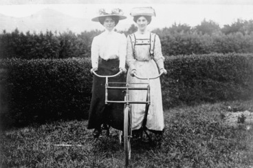 Image: Unidentified women on a bicycle made for two