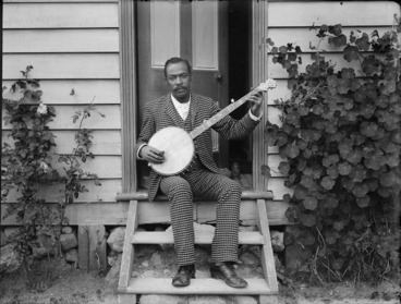 Image: Banjo player, probably Hosea Easton, at home of William and Lydia Williams, Carlyle Street, Napier