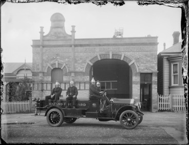 Image: Firemen on a fire engine outside the Ponsonby Fire Station, Auckland