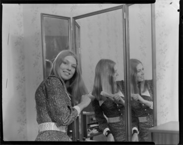 Image: Woman looking in mirror