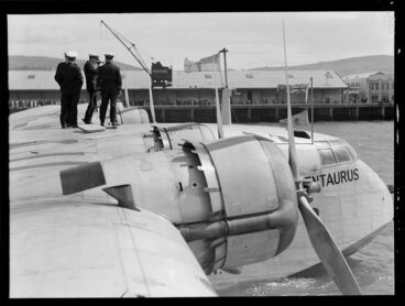 Image: Probably crew members, standing on the flying boat, Centaurus, Dunedin Harbour