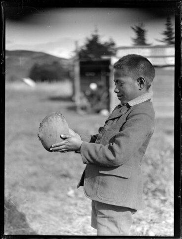 Image: Maori boy with a rugby ball, Waikato