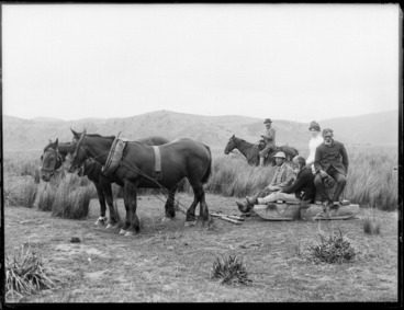 Image: Lydia Williams and unidentified men on a horse-drawn wooden sled, at Whakaki, Wairoa District