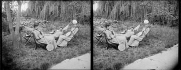 Image: An unidentified woman, Miss Rowbottom of Shakespeare Terrace (seated on right), and Lydia Myrtle Williams (in hammock), all of whom are holding banjos, in the garden of Lydia and William Williams' Carlyle Street home, Napier, Hawkes Bay Region