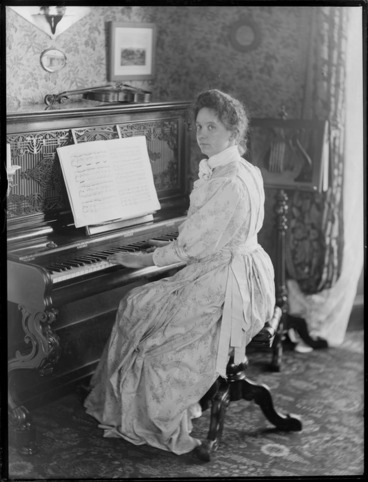 Image: Unidentified woman playing piano, location unknown