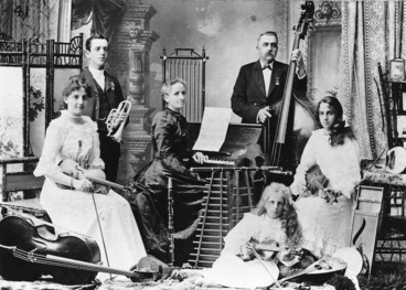 Image: The Black family, also known as the Musical All Blacks of Maori Land, with their musical instruments